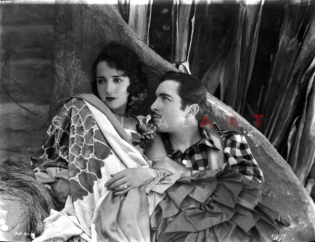 Bebe Daniels Leaning Back on the Wall with a Man in White Floral Dress Premium Art Print
