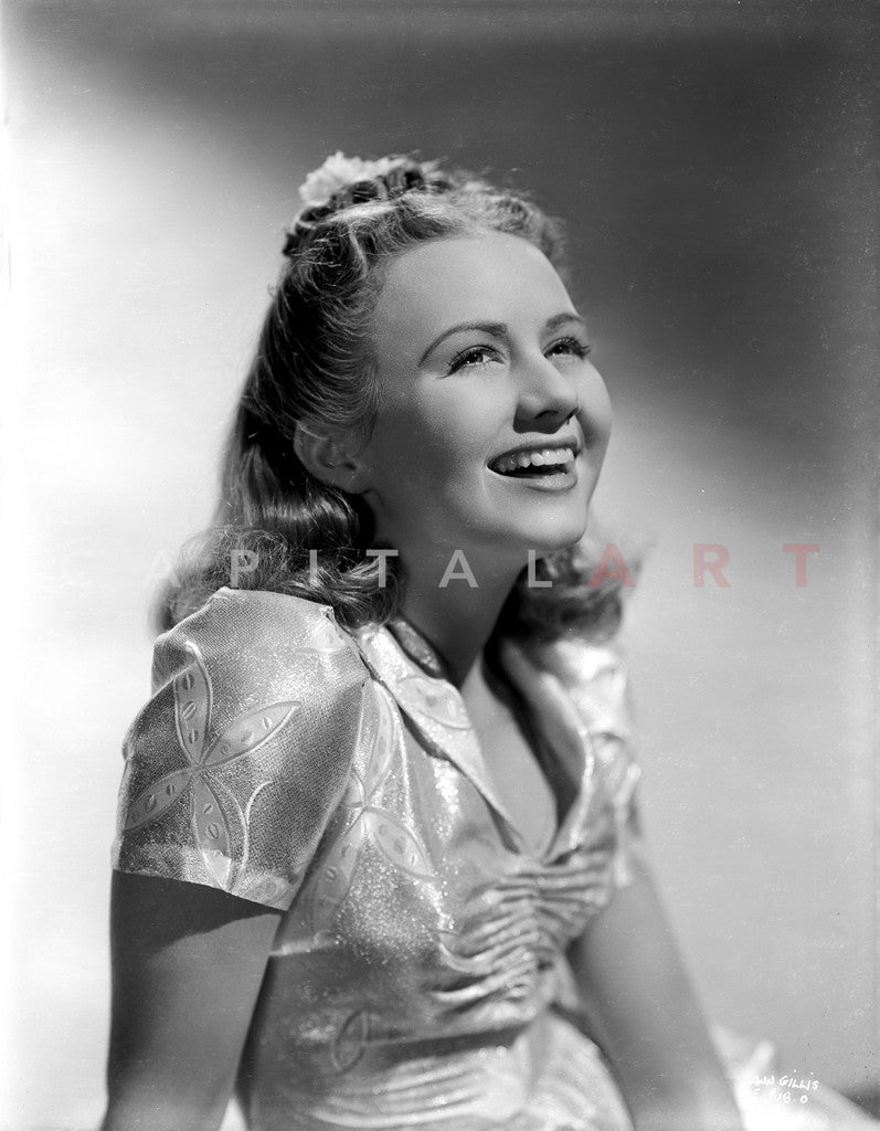 Ann Gillis wearing a Silk Top and smiling in Portrait Premium Art Print
