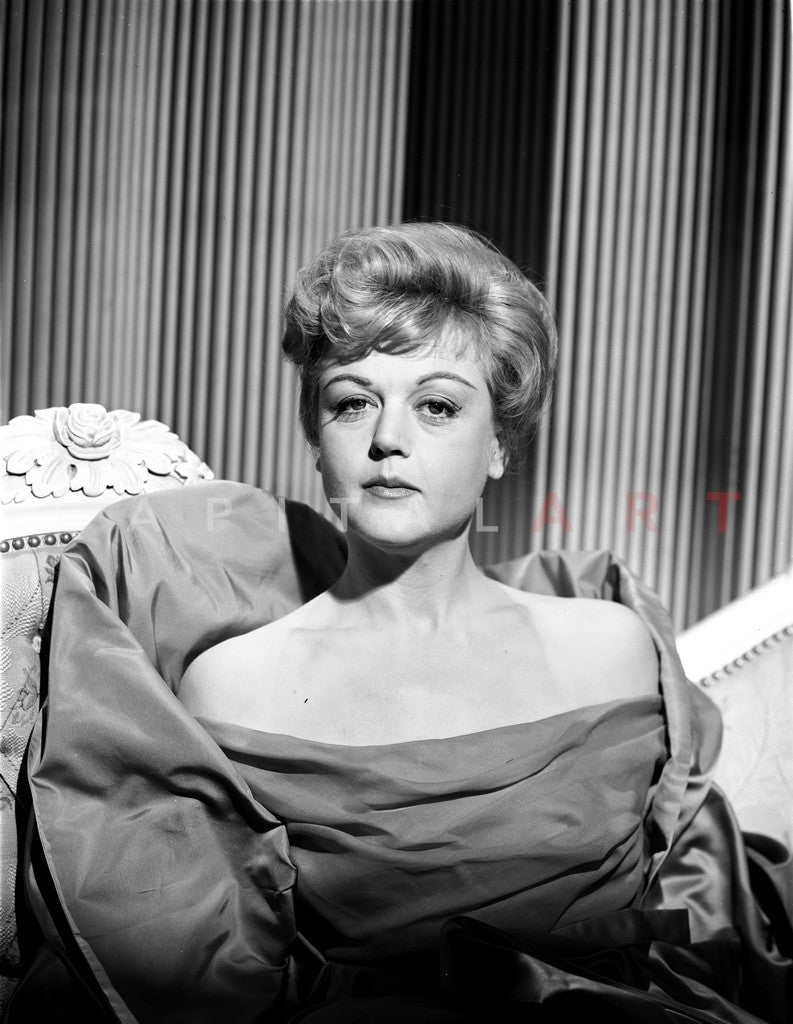 Angela Lansbury sitting on the Chair wearing a Dress Premium Art Print