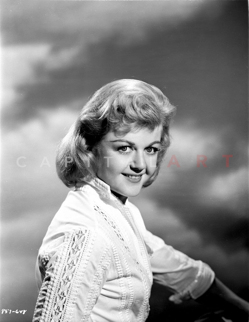 Angela Lansbury on a White Long Sleeve sitting and smiling Premium Art Print
