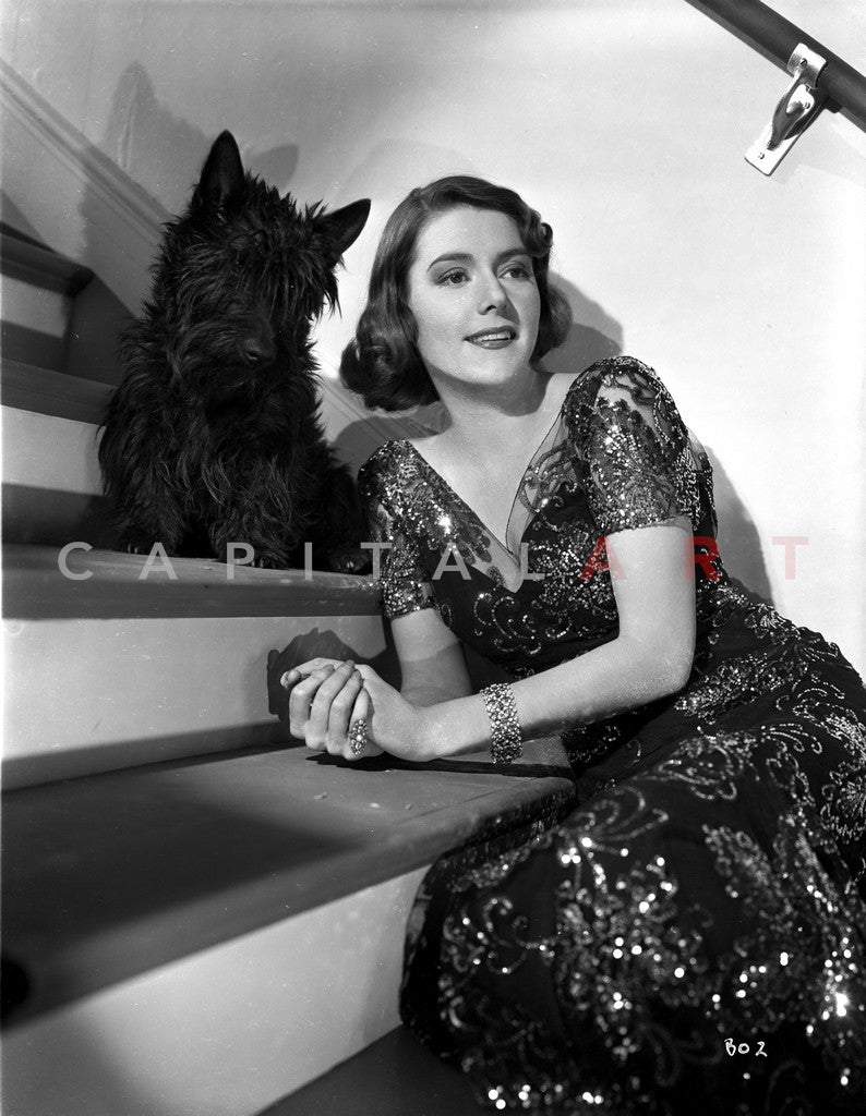 Barbara O'Neil on Embroidered Dress posed with Dog Premium Art Print