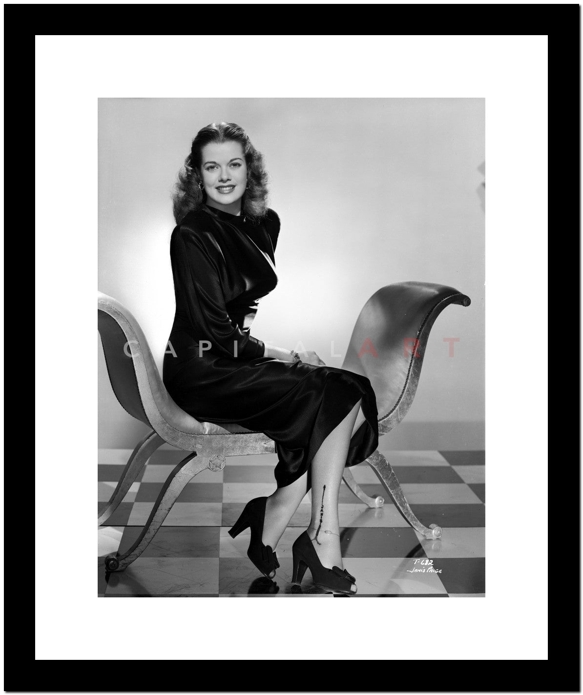 Janis Paige Sitting On A Chair In Black High Neck Long Sleeve Velvet