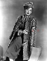 Ann Sheridan Leaning on the Chair, wearing a Coat Dress Premium Art Print