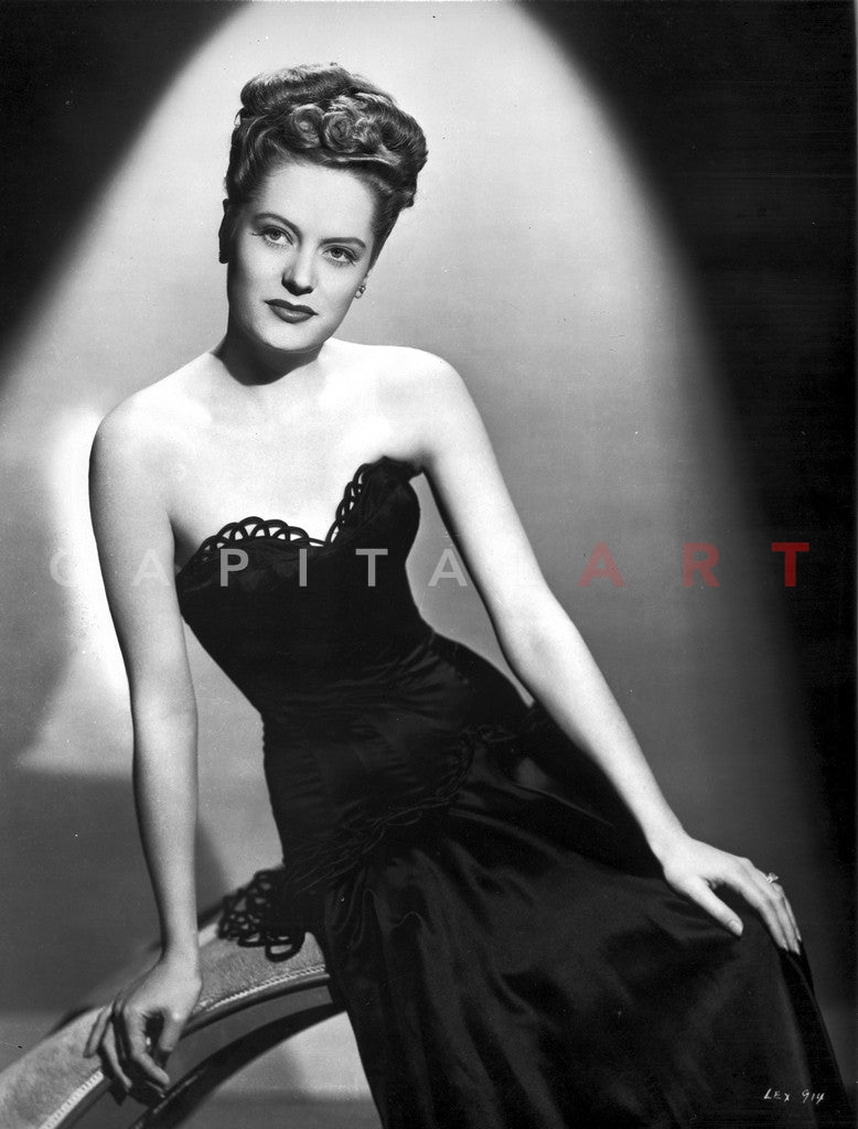 Alexis Smith sitting and wearing a Black Dress Premium Art Print