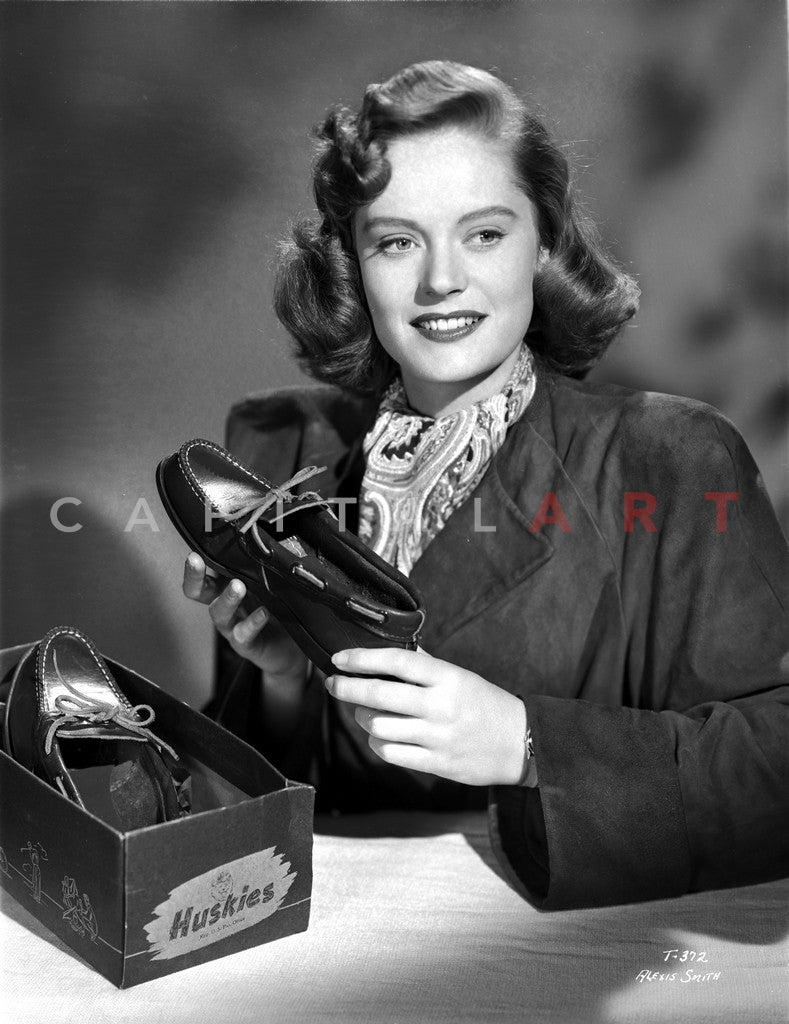 Alexis Smith Holding a Shoe while smiling in a Classic Portrait Premium Art Print