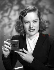 Alexis Smith Posed in Black Coat wearing a Wrist Watch Premium Art Print