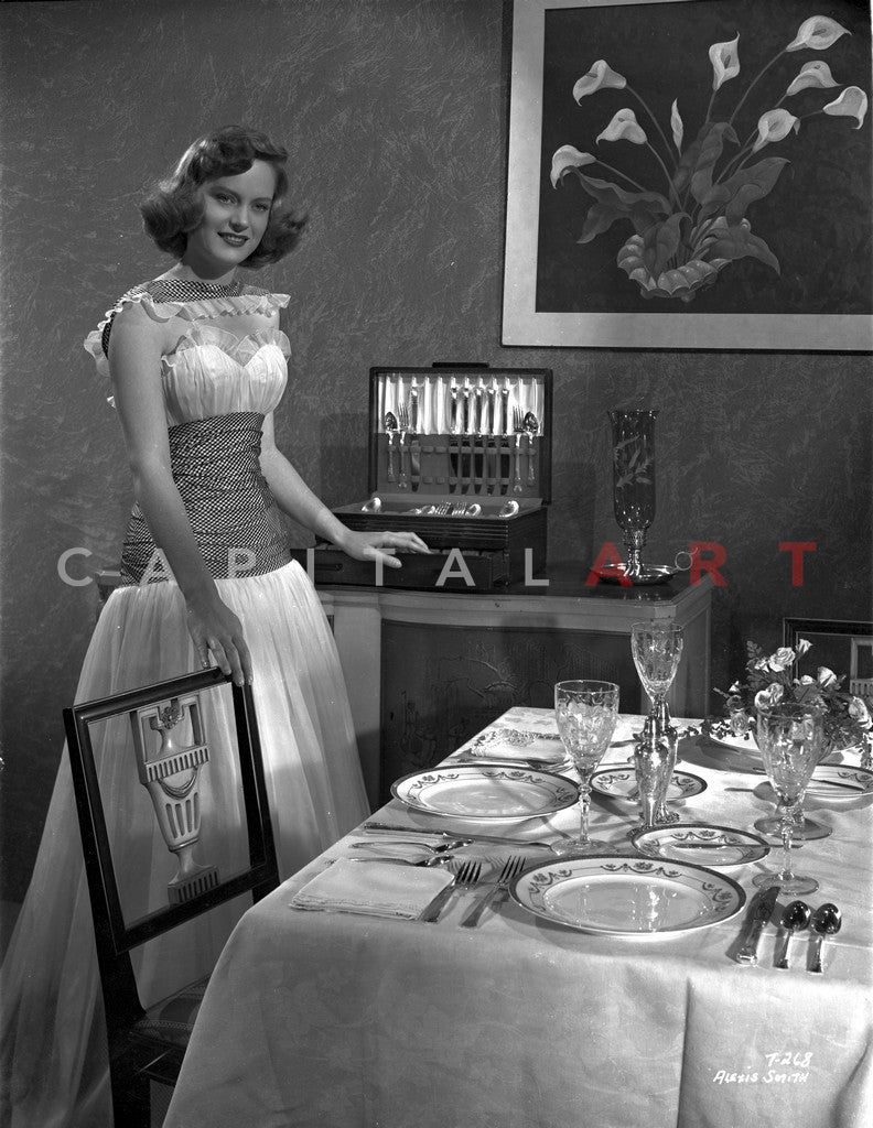 Alexis Smith standing Beside the Dining Table Premium Art Print