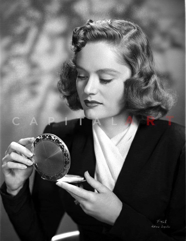 Alexis Smith Looking in a Small Mirror wearing Black Suit Premium Art Print
