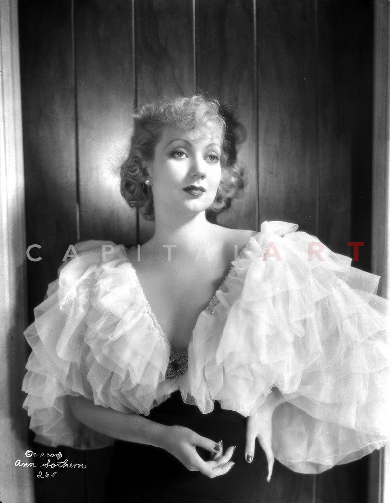 Ann Sothern wearing a Big Cap Sleeve Dress Premium Art Print