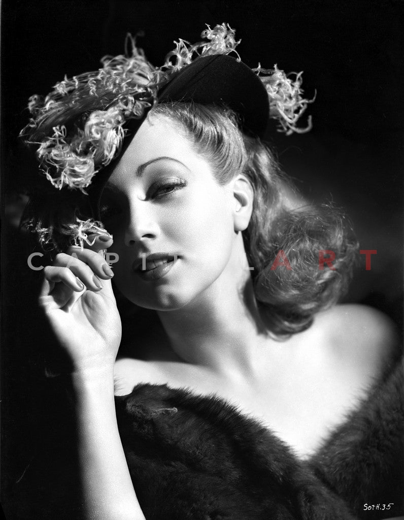 Ann Sothern wearing a Hat and A Furry Dress Premium Art Print