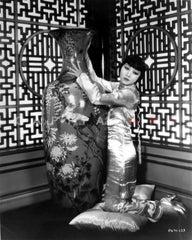 Anna Wong sitting on the Floor with Dragon Background Premium Art Print