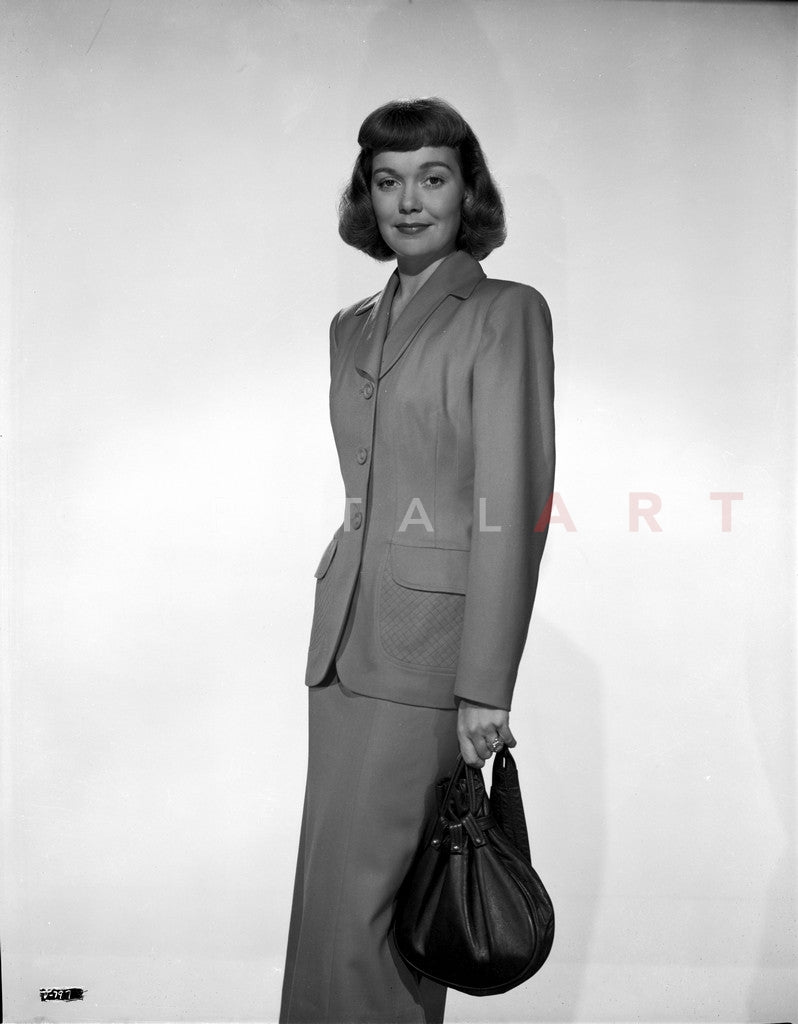 3bc2ba02382 Jane Wyman Posed in Grey Linen Long Sleeve Tweed Suit Dress and Long S –  Celebrity Vault