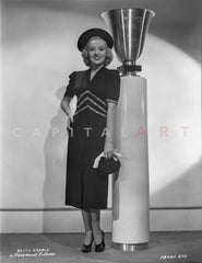 Betty Grable Posed standing Beside a Concrete Roman Column in Black Backless Strap Dress with Short Skirt Premium Art Print