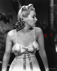 Betty Grable Posed Leaning Back with Arms Swayed Back in Black Strap Silk Dress with Black Sheer Silk Skirt Premium Art Print