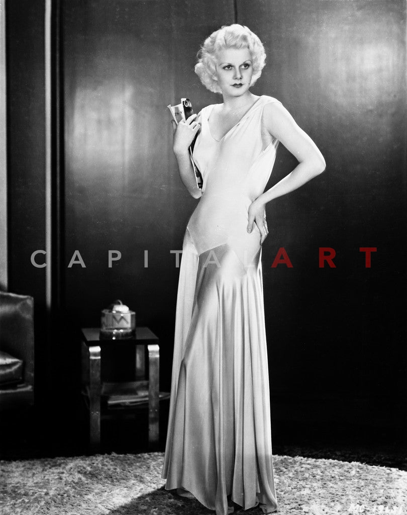 66b75f31c5 Jean Harlow Posed in White Strap Dress with Long Straight Pleated Skir –  Celebrity Vault