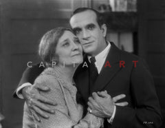 Al Jolson Accompanying a Woman in a Crowd in a Classic Portrait Premium Art Print