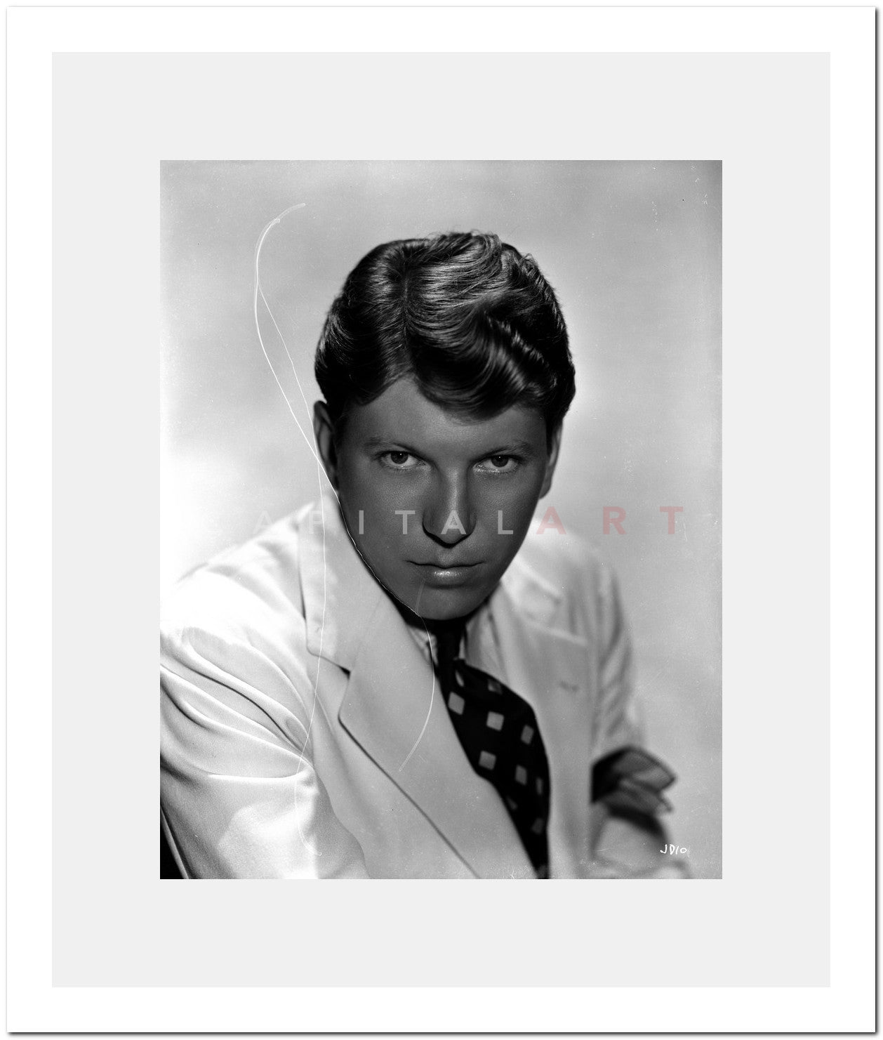 Johnny Davis Posed in White Tuxedo With White Background Premium