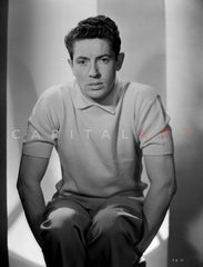 Farley Granger sitting in Stripes polo shirt Premium Art Print