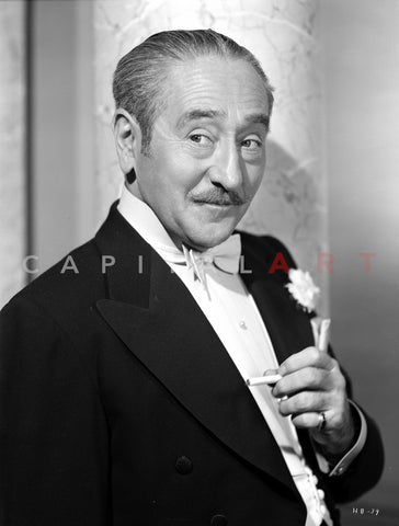 Adolph Menjou Posed in Black Suit With Flower Premium Art Print