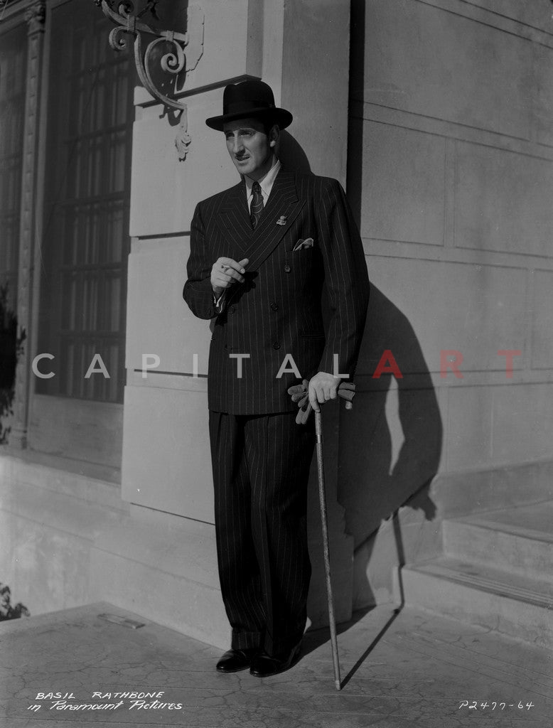 Basil Rathbone posed in Suit with Staff Premium Art Print