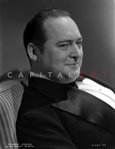Edward Arnold Seated in Black Suit Premium Art Print