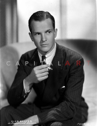 Allan Baxter sitting in Black Suit With Cigarette Premium Art Print