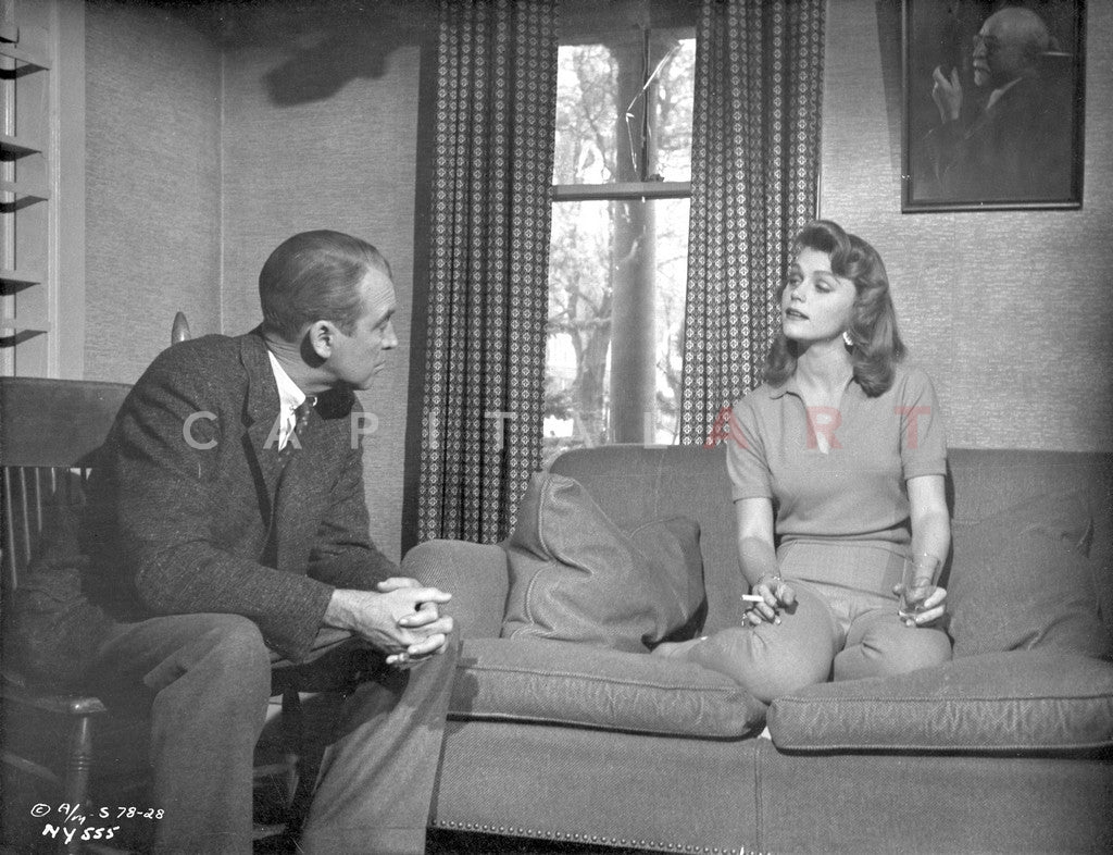 Anatomy Of A Murder Woman Talking To A Guy While Sitting On The Sofa