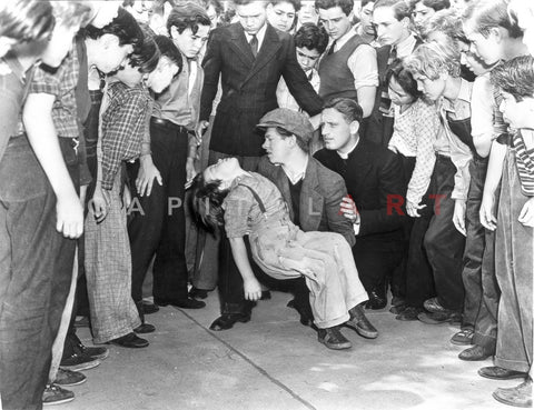 Boys Town Man Carrying Fainted Kid Surrounded by People Scene Excerpt from Film Premium Art Print