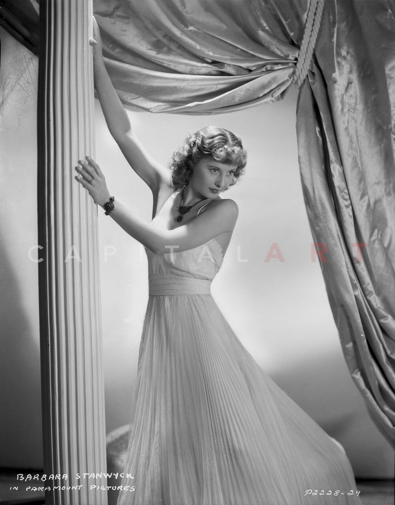 Barbara Stanwyck Leaning in Long White Gown Premium Art Print