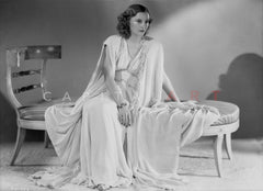 Barbara Stanwyck sitting in Sleevless Classic Portrait Premium Art Print
