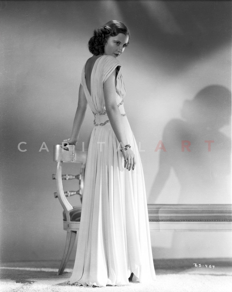 Barbara Stanwyck Showing Her Back in Long White Gown Premium Art Print