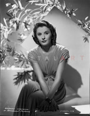 Barbara Stanwyck sitting in Bed Classic Portrait Premium Art Print