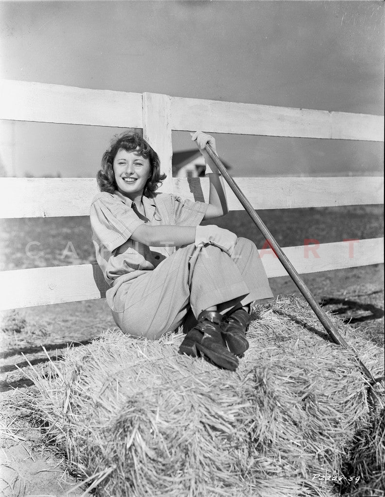 Barbara Stanwyck sitting in Hay Stack Classic Portrait Premium Art Print
