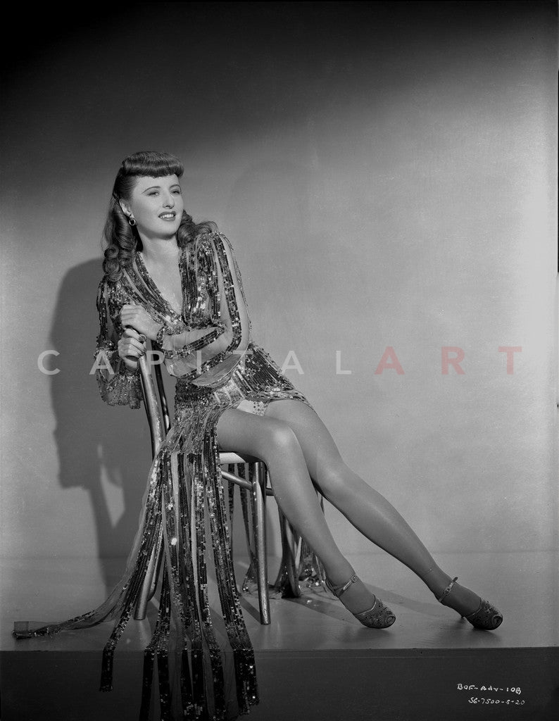Barbara Stanwyck sitting on Chair in Black and White Portrait Premium Art Print