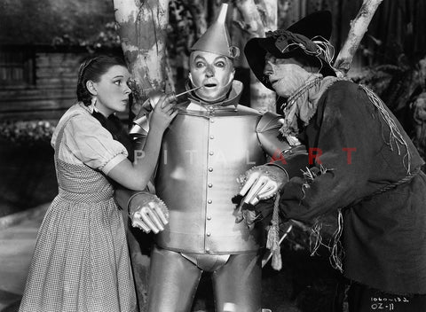 Wizard Of Oz Dorothy Helping Tin Man with Scarecrow in Movie Scene- Photograph Print Premium Art Print