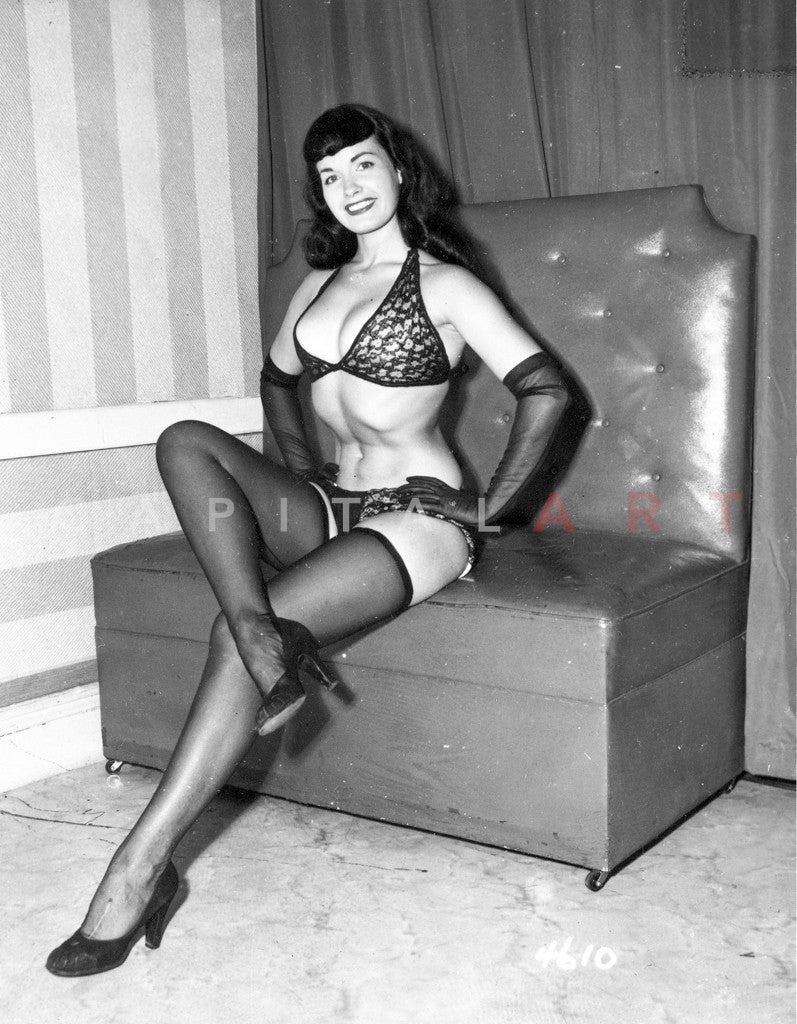 Bettie Page Seated With Legs Crossed Wearing Animal Print