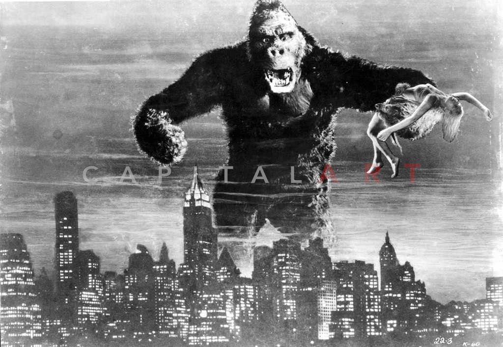 King Kong holding Fay Wray beyond the City Skyline Master Print
