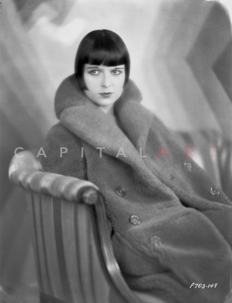 Louise Brooks sitting on Couch, wearing Fur Coat Portrait Master Print