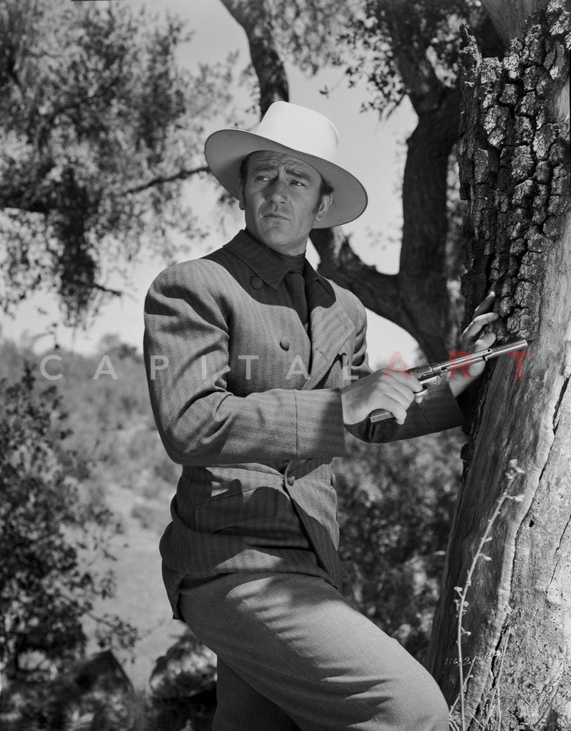 John Wayne with gun and hat Master Print