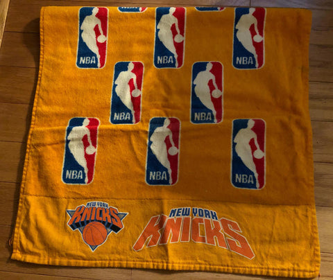 A vintage NBA towel with NBA Logos all over it