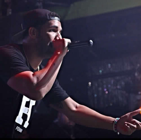 Drake wearing a T-Shirt designed by Rude Vogue