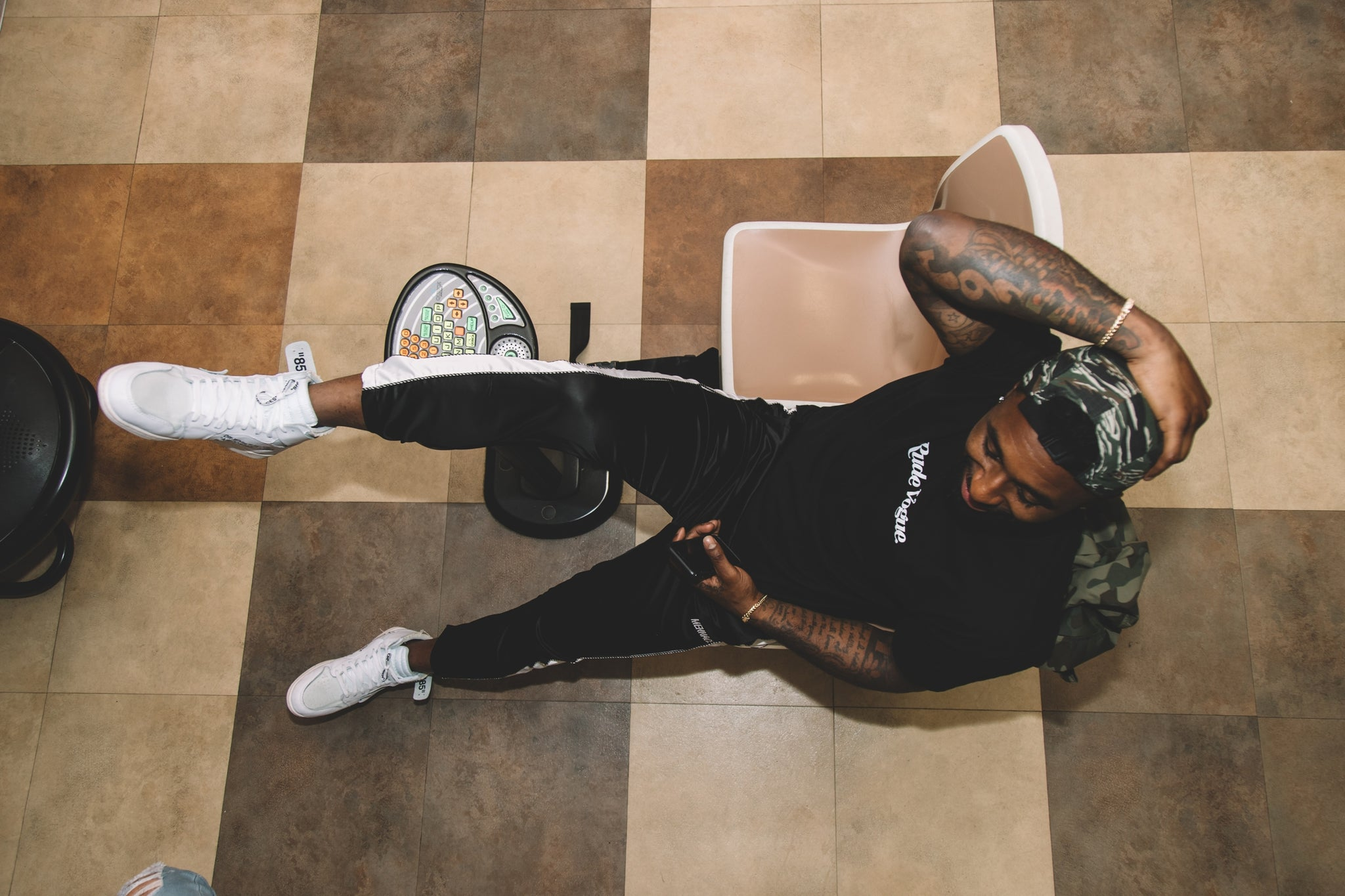 Cleveland Browns Wide Receiver Jarvis Landry laying back in a bowling alley for the Spring Summer 2018 Photo Shoot