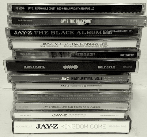 Stack of black and white classic Jay-Z CD's and Discography