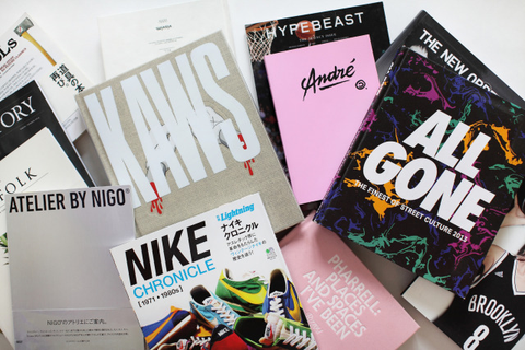 Nike, Kaws, Hypebeast Magazine layed out on the floor