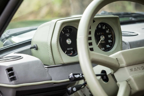 Vintage Range Rover interior with a leather Cream and Grey Dashboard and Steering Wheel