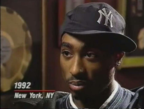 2pac in 1992 in New York wearing a sideways New York Yankees hat