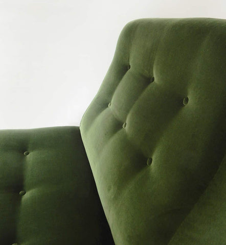 A moss green suede vintage love seat