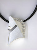 The Statement© in sterling silver with white diamonds