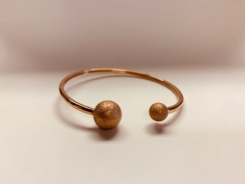 Stainless Steel Rose Gold Bracelet With Glittery Tone Spheres.