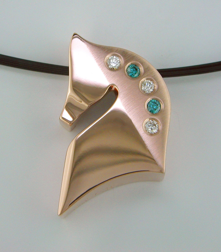 The Statement© in 14kt Rose Gold with teal and white diamonds